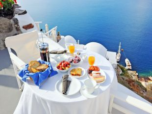 Breakfast on a terrace overlooking the sea in Oia, Santorini, Cyclades, Greece