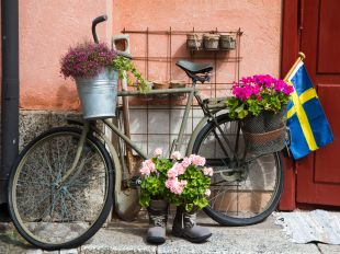 Flower decorated bike in Stockholm. Picture taken at an old military center.